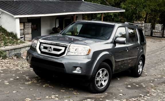 The 2009 Honda Pilot Touring 4WD Is A Solid Mid Sized SUV That Is Reliable  And Delivers A Balanced Power Output. It Provides Extra Security In  Slippery Road ...